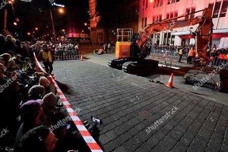 Crowds witness Hobart's Macquarie St being excavated to encase artist Mike Parr during Tasmania's Dark Mofo festival in Hobart, Australia, 14 June 2018.