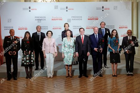 Spain's Emeritus Queen Sofia (C) and Spanish Labor, Migrations and Welfare Minister, Magdalena Valerio (3-L) pose for a group photo with the winners during the Mapfre Foundation awarding ceremony in Madrid, Spain, 14 June 2018. Former Spanish national team's head coach Vicente del Bosque, Brazilian NGO Turma do Bem, Latin American Health Link Foundation, Pennsylvania University and Latin American Firefighters Organization were awarded by the foundation.