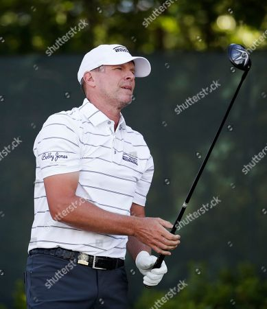 Steve Stricker watches his shot off the second tee during the first round of the U.S. Open Golf Championship, in Southampton, N.Y