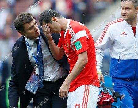 Russia's Alan Dzagoev injured during the group A match between Russia and Saudi Arabia which opens the 2018 soccer World Cup at the Luzhniki stadium in Moscow, Russia