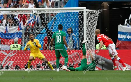 Russia's Yuri Gazinsky, right, scores his side's opening goal during the group A match between Russia and Saudi Arabia which opens the 2018 soccer World Cup at the Luzhniki stadium in Moscow, Russia