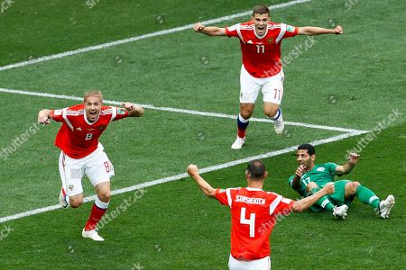 Russia's Yuri Gazinsky, left, celebrates scoring his side's first goal against during the group A match against Saudi Arabia which opens the 2018 soccer World Cup at the Luzhniki stadium in Moscow, Russia