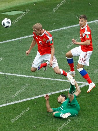 Russia's Yuri Gazinsky scores his side's first goal against during the group A match against Saudi Arabia which opens the 2018 soccer World Cup at the Luzhniki stadium in Moscow, Russia