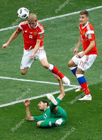 Russia's Yuri Gazinsky heads the ball to score his side's first goal against Saudi Arabia during the group A match, which opened the 2018 soccer World Cup at the Luzhniki stadium in Moscow, Russia