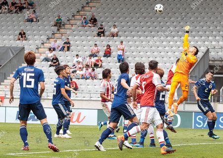 Japan's goalkeeper Kosuke Nakamura (2-R) in action during the international friendly soccer match between Japan and Paraguay at the Tivoli Stadium in Innsbruck, Austria, 12 June 2018.