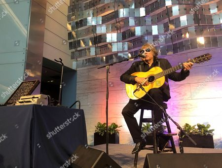 """Grammy Award-winning artist Jose Feliciano performs the """"Star-Spangled Banner"""" at the Smithsonian' National Museum of American History in Washington, . Feliciano also donated objects reflecting his international career to the museum"""