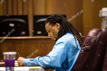 Joeviair Kennedy jots down notes during his trial, . The trial of Joeviair Kennedy for the murder of WMU student Jacob Jones continues in the Kalamazoo County Courthouse, June 7, 2018. Rebekah Welch, Kalamazoo Gazette/Kalamazoo Gazette via AP
