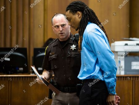 Joeviair Kennedy stands to be escorted from the courtroom, . The trial of Joeviair Kennedy for the murder of WMU student Jacob Jones continues in the Kalamazoo County Courthouse, June 7, 2018