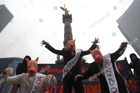 Stock Picture of Activists wearing pig masks protest against the alleged cover-up of Executive Director of UNAIDS (Joint United Nations Programme on HIV and AIDS) Michel Sidibe in a case of sexual harassment, in Mexico City, Mexico, 14 June 2018.