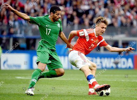 Stock Image of Alexandr Golovin and Saudi football player Taisir Al-Jassim