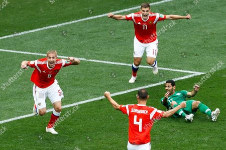 Russia's Yuri Gazinsky, left, celebrates scoring his side's first goal during the group A match against Saudi Arabia which opens the 2018 soccer World Cup at the Luzhniki stadium in Moscow, Russia