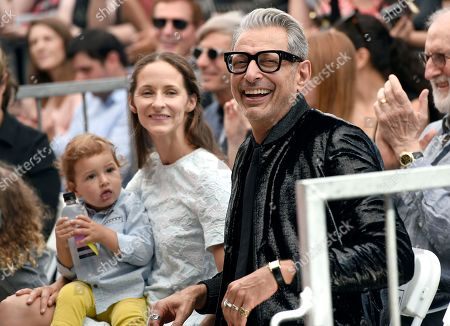 """Jeff Goldblum, Emilie Livingston. Actor Jeff Goldblum, right, best known for his roles in """"The Fly,"""" """"Independence Day"""" and """"Jurassic Park,"""" attends a ceremony honoring him with a star on the Hollywood Walk of Fame, in Los Angeles. Looking on is Emilie Livingston, center, and son River Joe"""