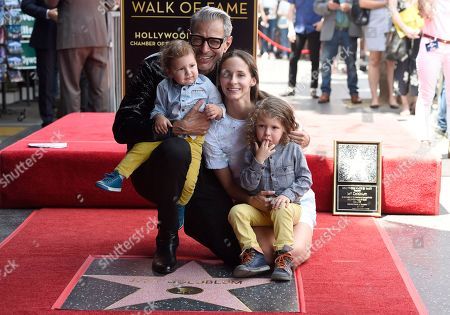 """Jeff Goldblum, Emilie Livingston. Actor Jeff Goldblum, background left, best known for his roles in """"The Fly,"""" """"Independence Day"""" and """"Jurassic Park,"""" wife Emilie Livingston, background right, and their children, River Joe, foreground left, and Charlie Ocean pose atop Goldblum's star on the Hollywood Walk of Fame following a ceremony in his honor, in Los Angeles"""