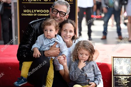 """Stock Image of Jeff Goldblum, Emilie Livingston. Actor Jeff Goldblum, background left, best known for his roles in """"The Fly,"""" """"Independence Day"""" and """"Jurassic Park,"""" wife Emilie Livingston, background right, and their children, River Joe, foreground left, and Charlie Ocean pose following a ceremony honoring Goldblum with a star on the Hollywood Walk of Fame, in Los Angeles"""