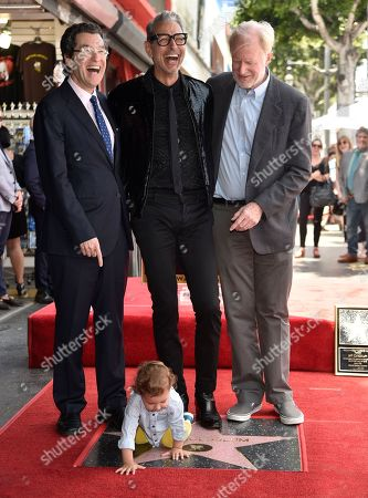 """Stock Picture of Norman L. Eisen, Jeff Goldblum, Ed Begley Jr. Norman L. Eisen, from left, honoree and actor Jeff Goldblum, best known for his roles in """"The Fly,"""" """"Independence Day"""" and """"Jurassic Park,"""" and Ed Begley Jr. look on as Goldblum's son River Joe plays atop his father's star on the Hollywood Walk of Fame following a ceremony in his honor, in Los Angeles"""