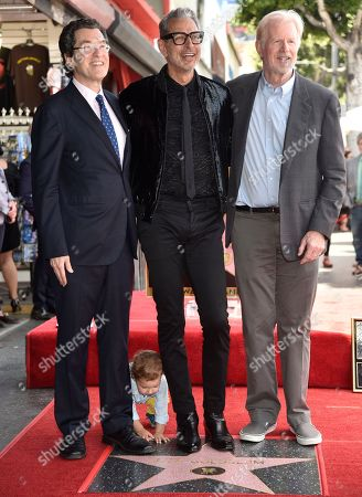 """Norman L. Eisen, Jeff Goldblum, Ed Begley Jr. Norman L. Eisen, from left, honoree and actor Jeff Goldblum, best known for his roles in """"The Fly,"""" """"Independence Day"""" and """"Jurassic Park,"""" and Ed Begley Jr. look on as Goldblum's son River Joe plays atop his father's star on the Hollywood Walk of Fame following a ceremony in his honor, in Los Angeles"""