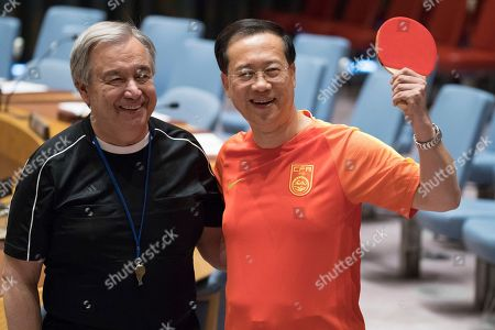 Antonio Guterres, Ma Zhaoxu. United Nations Secretary-General Antonio Guterres, wearing a referee jersey, poses for a photo with Chinese Ambassador to the United Nations Ma Zhaoxu holding a ping pong paddle after they posed for a photo of the Security Council Abassadors wearing the jerseys of their country's soccer teams, at United Nations headquarters. Russian Ambassador to the United Nations Vassily Nebenzia, who is the current president of the Security Council, organized the photo op in honor of the first day of the World Cup Soccer championship