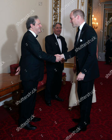Britain's Prince William, the Duke of Cambridge, right, shakes hands with David Cunningham, Director of Clinical Research of the Royal Marsden NHS Foundation Trust, during a reception for the Royal Marsden NHS Foundation Trust of which he is president, at Buckingham Palace, in London