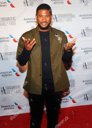 Usher Raymond IV, Usher. Usher poses for a photo at the 49th annual Songwriters Hall of Fame Induction and Awards gala at the New York Marriott Marquis Hotel, in New York