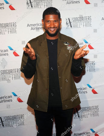 Stock Picture of Usher Raymond IV, Usher. Usher arrives at the 49th annual Songwriters Hall of Fame Induction and Awards gala at the New York Marriott Marquis Hotel, in New York