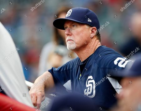 San Diego Padres bench coach Mark McGwire (25) watches from the during a baseball game against the Atlanta Braves, in Atlanta