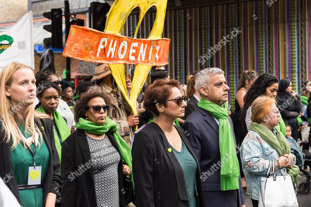 Mayor of London Sadiq Khan (CR) and his wife Saadiya Khan (CL) join tens of thousands of people taking part in the Silent March to commemorate the first anniversary of the Grenfell Tower fire, which took the lives of 72 people a year ago.