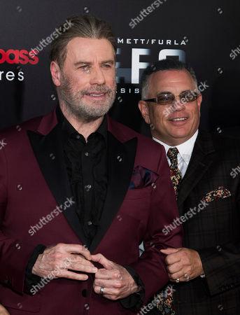"John Travolta, John Gotti, Jr. John Travolta, left, and John Gotti, Jr. attend the premiere of ""Gotti"" at the SVA Theatre, in New York"