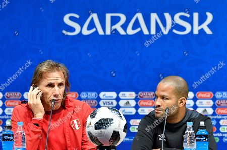 Peru head coach Ricardo Gareca, left, and Peru's Alberto Rodriguez talk to the media during Peru's official press conference on the eve of the group C match between Peru and Denmark at the 2018 soccer World Cup in the Mordovia Arena in Saransk, Russia
