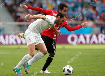 Diego Godin (L) of Uruguay and Kahraba of Egypt  in action during the FIFA World Cup 2018 group A preliminary round soccer match between Egypt and Uruguay in Ekaterinburg, Russia, 15 June 2018.