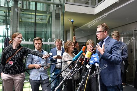 Konstantin von Notz of the Alliance 90/The Greens party (Gruene) gives a statement to the media as he arrives at the Bundestag's interior committee in Berlin, Germany, 15 June 2018. The committee met on the topic of procedural errors in approved asylum applications by the local Bremen branch of the Office for Migration and Refugees (Bundesamt fuer Migration und Fluechtlinge - BAMF). Procedural errors in some 1,200 applications approved in 2015, mostly form Yazidis whose approval rates where at 86 percent between 2013 and 2017, are in question and the BAMF is blamed for encouring its staff to be significantly less thorough in evaluating the asylum applications from Yazidis at that time.