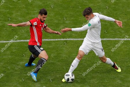 Uruguay's Rodrigo Bentancur, right, vies for the ball with Egypt's Shikabala during the group A match between Egypt and Uruguay at the 2018 soccer World Cup in the Yekaterinburg Arena in Yekaterinburg, Russia