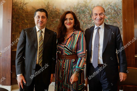 Angela Missoni, center, is flanked by Michele, Norsa, right, and Maurizio Tamagnini during a press conference in Milan, Italy, . The family-owned Missoni fashion house has announced that the Italian investment fund FSI will take a 41.2 percent stake to help expand the business