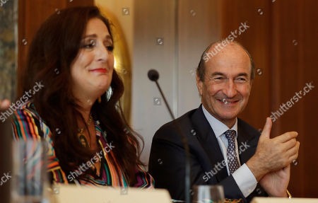 Angela Missoni, left, is flanked by Michele Norsa, during a press conference in Milan, Italy, . The family-owned Missoni fashion house has announced that the Italian investment fund FSI will take a 41.2 percent stake to help expand the business