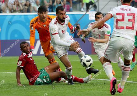 Ayoub El Kaabi of Morocco, Goalkeeper Ali Beiranvand of Iran and Roozbeh Cheshmi of Iran