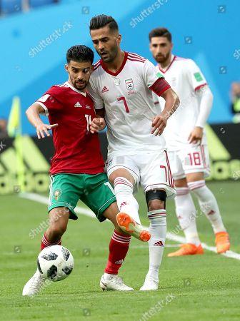 Masoud Shojaei of Iran and Mbark Boussoufa of Morocco