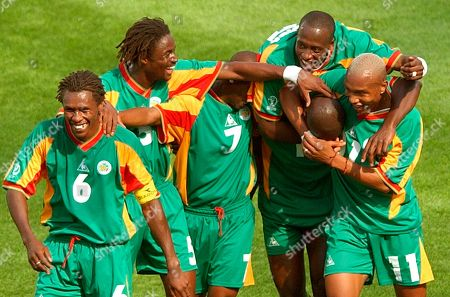 Senegal's players celebrate after scoring their third goal in the first half of their 2002 World Cup Group A soccer match against Uruguay at the Suwon World Cup stadium in Suwon, South Korea. From left are Aliou Cisse, Alassane Ndour, Henri Camara, Khalilou Fadiga, Papa Bouba Diop (hidden) and El Hadji Diouf. The other teams in Group A are France and Denmark