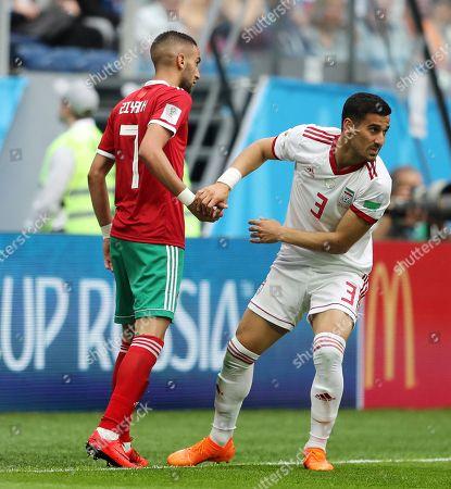 Hakim Ziyech of Morocco and Ehsan Hajsafi of Iran