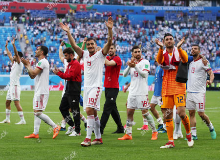 Stock Image of Majid Hosseini and Iran goalkeeper Mohammad Rashid Mazaheri thank the fans at the end of the game