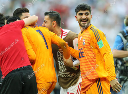 Stock Image of Iran goalkeeper Amir Abedzadeh celebrates at the end of the game