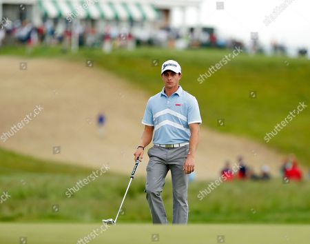 Cole Miller prepares to putt on the first green during the second round of the U.S. Open Golf Championship, in Southampton, N.Y
