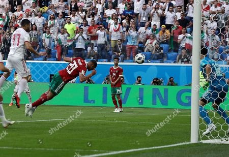 Morocco's Aziz Bouhaddouz, 20, scores own goal during the group B match between Morocco and Iran at the 2018 soccer World Cup in the St. Petersburg Stadium in St. Petersburg, Russia