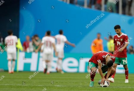 Morocco's Younes Belhanda waits at the kick off point after his teammate Aziz Bouhaddouz scored an own goal during the group B match between Morocco and Iran at the 2018 soccer World Cup in the St. Petersburg Stadium in St. Petersburg, Russia