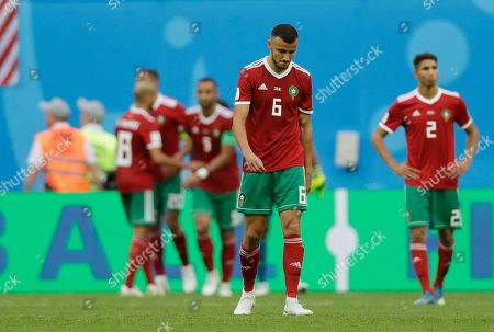 Morocco's Romain Saiss react after his teammate Aziz Bouhaddouz scored an own goal during the group B match between Morocco and Iran at the 2018 soccer World Cup in the St. Petersburg Stadium in St. Petersburg, Russia
