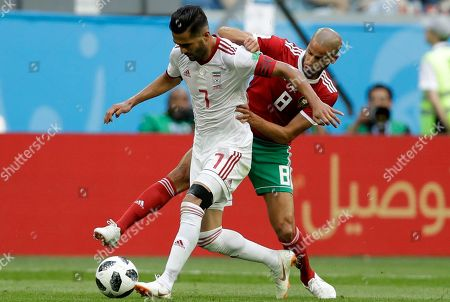 Iran's Masoud Shojaei, left, and Morocco's Karim El Ahmadi, right, fight for the ball, during the group B match between Morocco and Iran at the 2018 soccer World Cup in the St. Petersburg Stadium in St. Petersburg, Russia