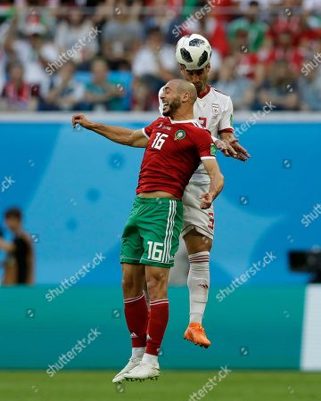 Morocco's Noureddine Amrabat, front, and Iran's Masoud Shojaei, vie for the ball, during the group B match between Morocco and Iran at the 2018 soccer World Cup in the St. Petersburg Stadium in St. Petersburg, Russia