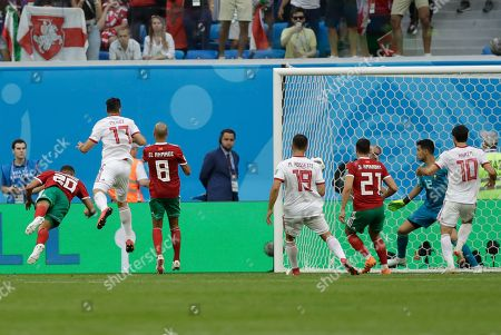 Morocco's Aziz Bouhaddouz, left, scores on his own goal during the group B match between Morocco and Iran at the 2018 soccer World Cup in the St. Petersburg Stadium in St. Petersburg, Russia