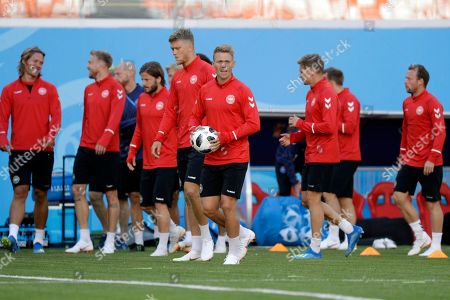 Denmark's Viktor Fischer, center, holds the ball during the official training on the eve of the group C match between Peru and Denmark at the 2018 soccer World Cup in the Mordovia Arena in Saransk, Russia