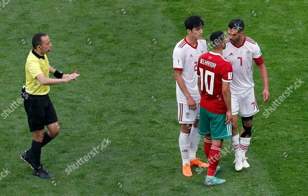 Iran's Masoud Shojaei, right, and Morocco's Younes Belhanda, 2nd right, talk during the group B match between Morocco and Iran at the 2018 soccer World Cup in the St. Petersburg Stadium in St. Petersburg, Russia
