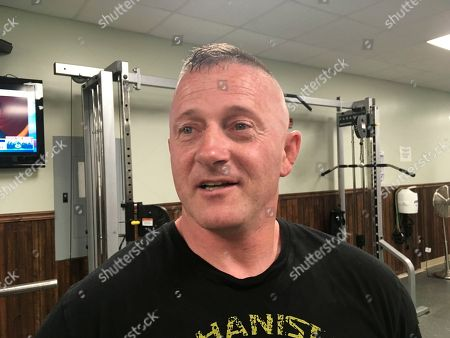 Richard Ojeda talks at a gym in Logan, W.Va. Ojeda is decorated with military medals and 26 tattoos and can bench press 300 pounds. The retired Army paratrooper doesn't fit the typical profile of the ideal candidate for Congress. Ojeda, a Democratic state senator, is running against Republican Delegate Carol Miller in November for West Virginia's 3rd District U.S. House seat