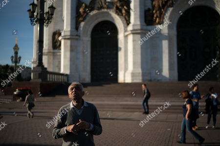 Brazilian singer Gilberto Gil stands outside the Cathedral of Christ the Saviour during the 2018 soccer World Cup in Moscow, Russia
